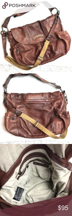"""B. Makowsky Brown Leather Hobo Rocker Bag B. Makowsky Studded Brown Leather Hobo Rocker Bag with canvas adjustable strap. Large pockets on either side. Thick shoulder strap. Magnetic front closure. Inside zip pocket and 2 slot pockets. Super soft heavy duty leather. This bag is beautiful! Has some light wear but overall in great condition! Approx. 15"""" wide and 10"""" tall. Leather strap-16"""" long. b. makowsky Bags Hobos"""