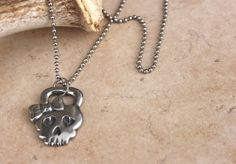 Image of Kettlebell with Bow Pendant