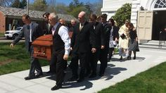 The casket of Emmett Scannell is carried out of Central Square Congregational Church on Wednesday, April 27, 2016, by his family members - including father Billy (in front, with white sleeves), who has been open about the heroin overdose that killed his son on April 20. — Charlie Peters/The Enterprise