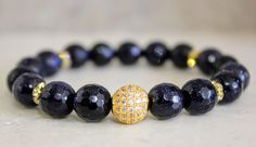 A personal favorite from my Etsy shop https://www.etsy.com/listing/519585907/blue-sandstone-gems-with-gold-pave