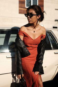 storm wears simon miller black bonsai bag with paloma wool red dress