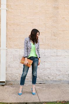 Floral jacket, bright top and shoes   with jeans; pearl necklace, neutral bag