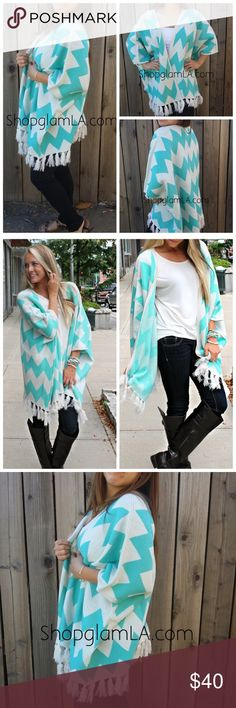 Mint chevron cardigan poncho sweater Mint chevron cardigan poncho sweater   Cozy on up to this trendy chevron zig cag Cardigan poncho. This knitted cardigan sweater features a wide cuff open collar neckline, quarter-length sleeves, and design with zig zag color throughout. 100% Acrylic Sweaters Cardigans