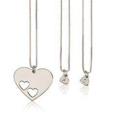 We love this set of personalized sterling silver engraved heart necklaces and cut out heart shaped pendant necklace. Select from 1 to 4 engraved initial heart necklaces  and heart pendant.