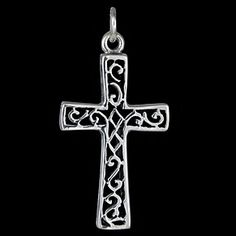 Silver pendant, carved cross Silver pendant, Ag 925/1000 - sterling silver. Carved cross. The cross is decorated with wave and rhombic patterns. The cross side is duplicated. Dimensions approx. 25x15x3mm.
