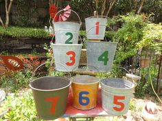 You could stencil table numbers on the centerpieces.