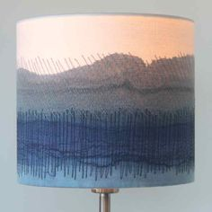 Dionne Swift Lampshades hand painted and stitched inspired by the horizons over the Yorkshire moors. Buy Dionne Swift lampshades at madebyhandonline Blue Lamp Shade, Lamp Shades, Light Shades, Light Table, Lamp Light, Handmade Lampshades, Creative Textiles, Standard Lamps, Fabric Pictures