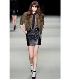 Saint Laurent Style Tip: Allow us to introduce you to your next party look: a cropped military jacket, sheer blouse, and leather skirt. Voila! ​Shop The Runway: Saint Laurent Cropped Military Jacket ($1490).
