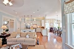 i want this exact layout - open kitchen with a breakfast nook overlooking a small living area