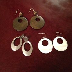 w/any $25 Purchase!! NWOT Earrings!!! 3 pair of earrings. All new w/out tags. Silver, wooden, and ivory/opalescent. FREE WITH A PURCHASE OF $25 OR MORE! Simply comment and let me know you are interested in this offer. Jewelry Earrings