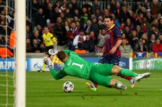 Lionel Messi of Barcelona has his shot saved by goalkeeper Joe Hart of Manchester City during the UEFA Champions League Round of 16, second leg match between FC Barcelona and Manchester City at Camp Nou on March 12, 2014 in Barcelona, Catalonia.
