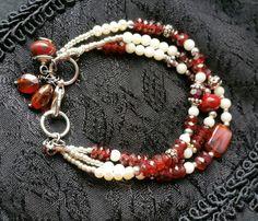 Check out this item in my Etsy shop https://www.etsy.com/listing/261669728/garnet-bracelet-january-birthstone-white