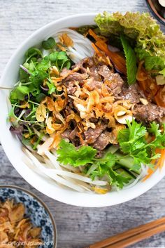 Vietnamese Beef Noodle Salad (Bun Bo Xao) is packed with crunchy veggies, refreshing herbs and flavorful beef. This healthy and tasty dish is quick and easy to make and can be either a main a side dish. Vietnamese Noodle, Vietnamese Recipes, Asian Recipes, Beef Recipes, Healthy Recipes, Vietnamese Cuisine, Ethnic Recipes, Asian Foods, Recipies