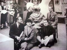 Paul Éluard, Nusch Éluard, Diana Brinton Lee, Salvador Dalí (in diving suit), E.L.T. Mesens (seated on the floor), Rupert Lee, June 11, 1936 – TheInternational Surrealist Exhibitionopens in New Burlington Galleries, London.