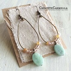Hand cut wire and hand beaded glass and gem stones make these earrings one of a kind.   The earrings measure a little over 2.5i nches from top to bottom