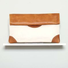 Love this camel and cloth clutch from @SEKO SEKO... made by survivors of conflict in #kenya