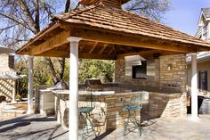 A Kansas outdoor kitchen with a pavilion for protection from the weather.