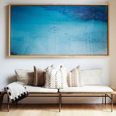 We like a good gallery wall as much as the next guy, but sometimes a room needs art that really packs a punch. Enter large-scale photography, the design trend t