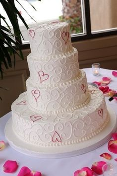 If I go with topper A, it will be this cake. Except minus the bottom-most layer, it seems a bit out of place to me. But I like the hearts <3 Perhaps make the swirls teal and the hearts purple? or vice versa.