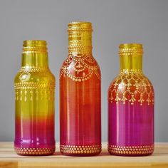 These painted bottle vases are perfect for your ombre wedding! You get a set of three hand painted ombre glass vases with golden henna art, just what