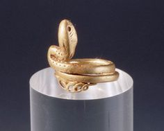 ‡ Gold Ring from Pompeii with Serpent Design. © Mimmo Jodice/Corbis