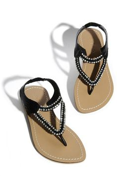 Black sandals in snake look