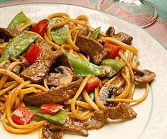 Peppery Beef and Vegetables This low-calorie recipe boasts plenty of Asian-inspired flavors. Beef and pea pods meet a peppery sauce and are tossed with strands of pasta.