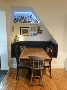 Dining booth under stairs …