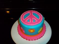 Peace Sign Cake This was a cake for a 12 yr olds pool party, all the mom said was that she likes peace signs and bright colors so this is. Peace Sign Cakes, Peace Cake, Hippie Birthday, Hippie Party, Cupcakes, Cupcake Cakes, Foundant, Birthday Ideas, 9th Birthday
