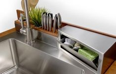 """A place for everything and everything in its place"" is the mantra of this small kitchen sink area."