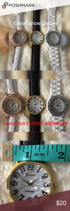 "Quartz Geneva Watches The 3 are unique Quartz, luxurious fashion watch crystal rhinestones around the Face, White PU leather wrist band 9 1/2"" long  Geneva Platinum, Beautiful mother of pearl look face, black PU leather wristband gold around the face Large black numbers. Black PU leather wrist band. All watches are stainless steel & 9 1/2"" long  Geneva Quartz, Lovely Rhinestones around the Silver face White silicone band 1 for $10 / 2 for $15 / 3 for $20 Quartz Accessories Watches"