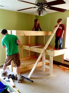 Raise bunks/ 3rd bed perpendicular and under...Building 3 Bunk Beds in a Small Space from the Handmade Dress. The only way I will share a room with my sisters. I want top bunk :)