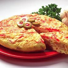 "Tortilla in the sense of ""omelet."" Goya Adobo makes it Puerto Rican."