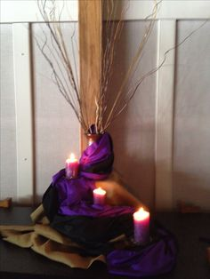 Lent Decor Idea. I love the use of the purple and the candles, and dead sticks