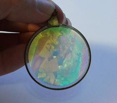 Holograph Religious Pendant by onetime on Etsy, $3.00
