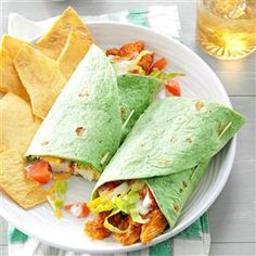 Buffalo Chicken Wraps Recipe -Blue cheese dressing and hot pepper sauce enhance these yummy tortilla wraps. Filled with chicken, cheese, lettuce and tomatoes, they're colorful, fun to eat...and tote-able, too! —Athena Russell, Florence, South Carolina