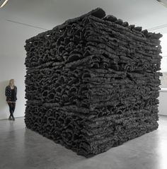 Behemoth by Jason Martin. Stacked raw cork coated in black pigment.