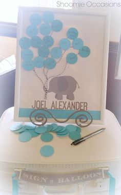 Paige's Blue and gray elephant Baby Shower. Sign a balloon guest sign in baby shower photo frame. Super Cute idea!   CatchMyParty.com