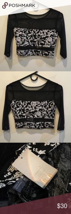 NWT Sparkle and Fade Black Mesh Crop Top New with tags sparkle and fade black and white with floral print and has a crop style. Size extra small. Sparkle & Fade Tops Crop Tops