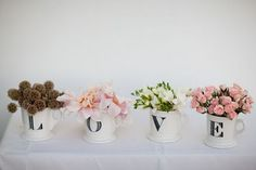 Ada and Darcy.blogspot.com/  | LOVE.  I like this idea but letters etched on glass cylindars to put the bouquets in at the head table.