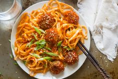Korean noodles are dressed in spicy sauce and served with savory tofu meatballs to make this flavor-packed Korean inspired meal.