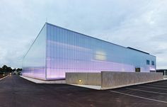 the site celebrates the science of light via reduced architecture by wrapping the entire concrete building with translucent polycarbonate and refinishing it with a dichroic protective coating which refracts and diffuses daylight.