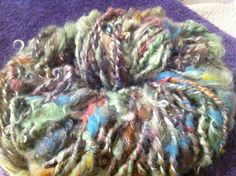 Homespun art yarn. Mainly mohair with added goodies to create texture.