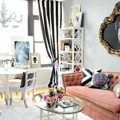 Beautiful cute french/arisian decor living room. Great for a girly apartment or studio apartment. Love the pink couch and black and white stripe curtains! Romantic flair.