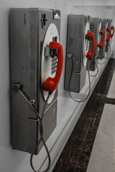 This photo represents repetition because the row of public telephones are exactly the same to one another.