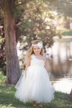 Adorable Flower Girl Dresses for the Little Miss in Your Wedding:   One Shouldered Flower Girl Dress with Embellished Flowers