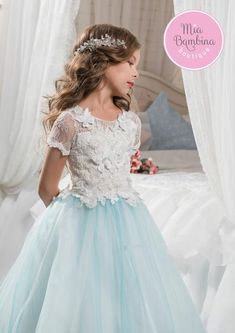 The Aurora is a flower girl dress with beautiful white lace overlayed bodice with short lace scalloped sleeves and a multi-layered tulle skirt. Lovely butterfli