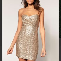 TFNC gold sequin bandeau mini dress Shimmer the night away in this eye-catching mini dress! The dress is a gold sequin mini dress with a bandeau sweetheart strapless top. As seen in the second picture, this dress features a sexy exposed zipper. Brand TFNC, sold by ASOS - now sold out. I've worn this dress only twice... It deserves to be the highlight of the night again! Lmk if you have any questions. ASOS Dresses Mini
