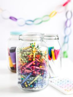 "Classic birthday party with all colors of the rainbow - Jars of crayons/markers as centerpieces and white craft paper ""tablecloth"" to doodle on."