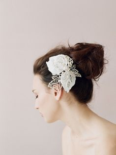 Using lace, metal charms, pearls, beads, and hand-applied Swarovski crystals, this Etsy seller creates beautiful vintage-looking hair adornments like this one.